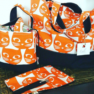 Big Bag Lunch Bag and diary case in white material with an orange cat print