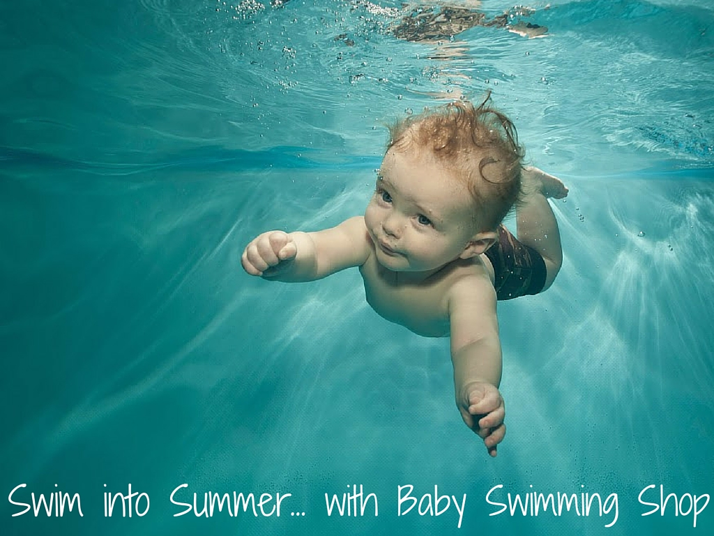 Baby swimming underwater with the title below
