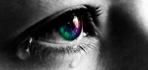 an open eye with a tear in it