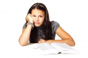 woman stressed ad bored with books