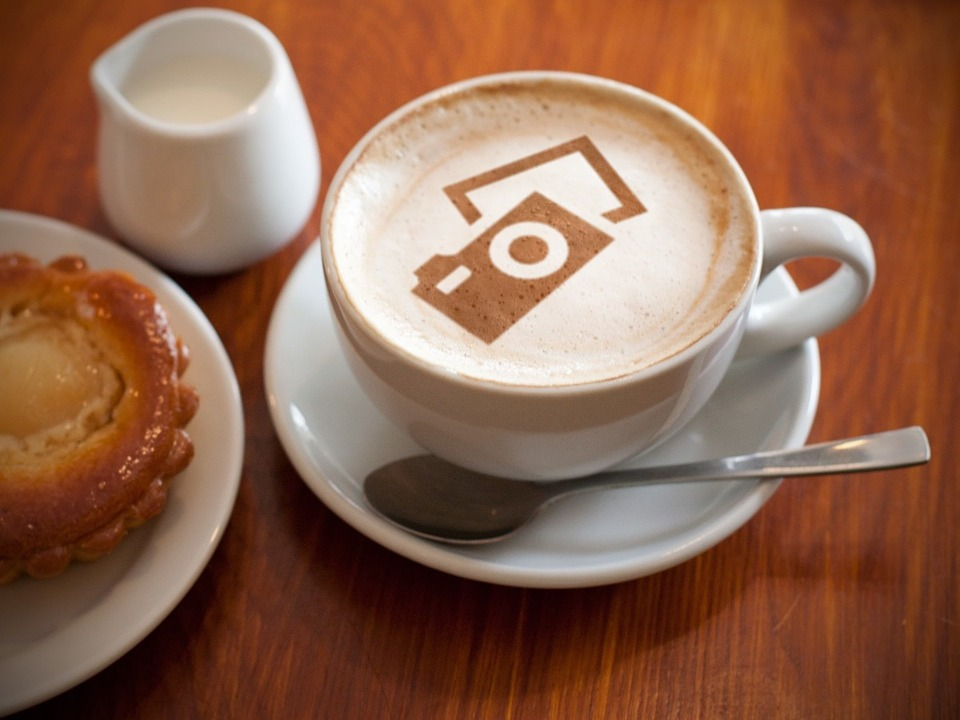 coffee with a camera in chocolate on top