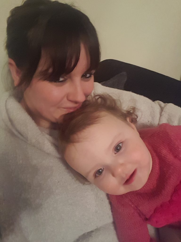 Alyssa and I cuddling and smiling looking at the camera