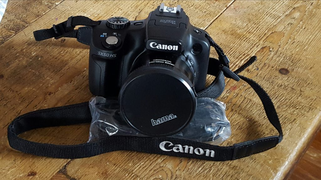 my new canon dslr camera sat on a wooden table