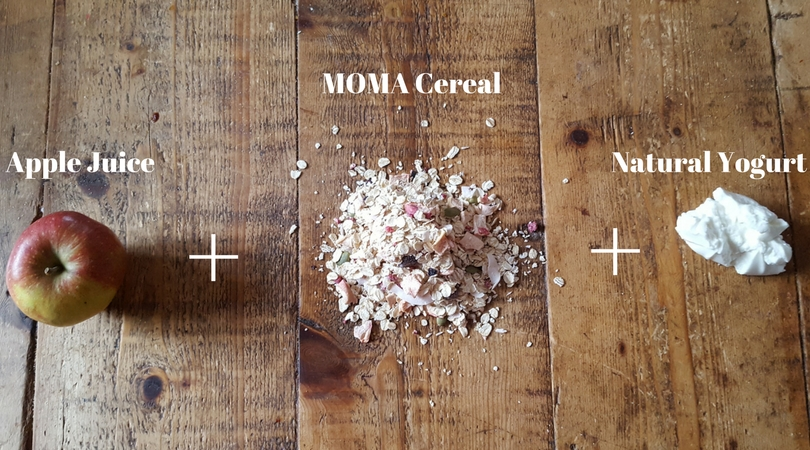 an apple a pile of MOMA oats and yogurt on a wooden table in a row with addition symbols between them