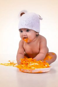 baby covered in carrot