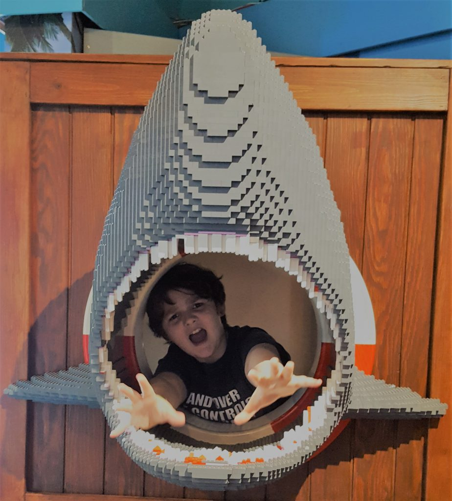 rowan jumping out through the mouth of a fierce lego shark