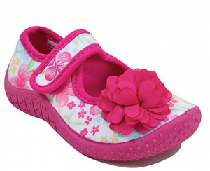 little pink and white shoes with a velcro strap and a little pink flower on the front