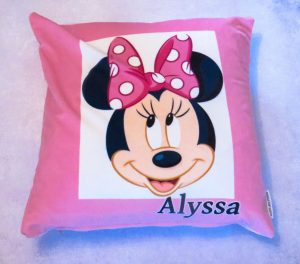 pink cushion with Minnie Mouse on the front smiling with Alyssa written in black below
