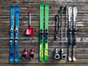 skis and poles on a wooden floor
