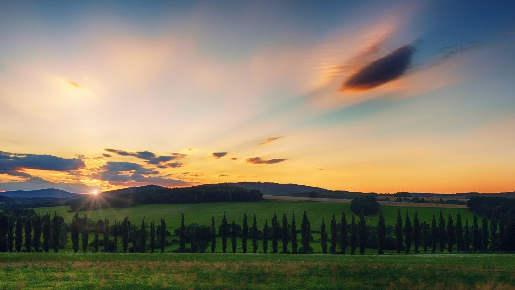 sunset in tuscany over green hills