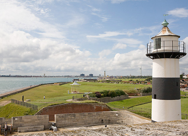 a view of the coastline with lighthouse from southsea castle