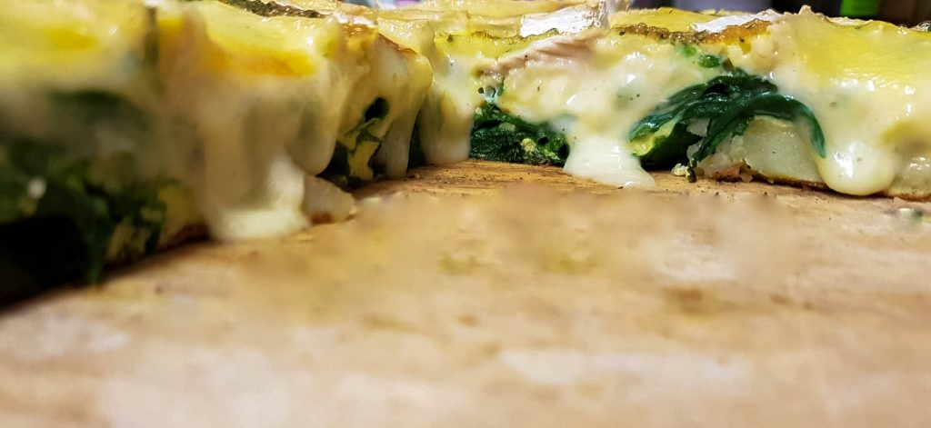the inside of the frittata with the cheese oozing