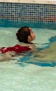 Alyssa swimming in a kiddie pool