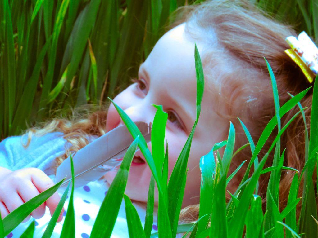 alyssa hiding in the grass