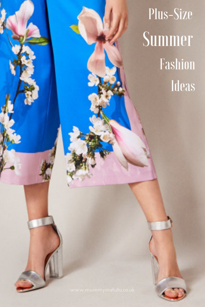 blue floral trousers and silver high-heeled shoes