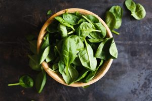 a bowl of basil leaves